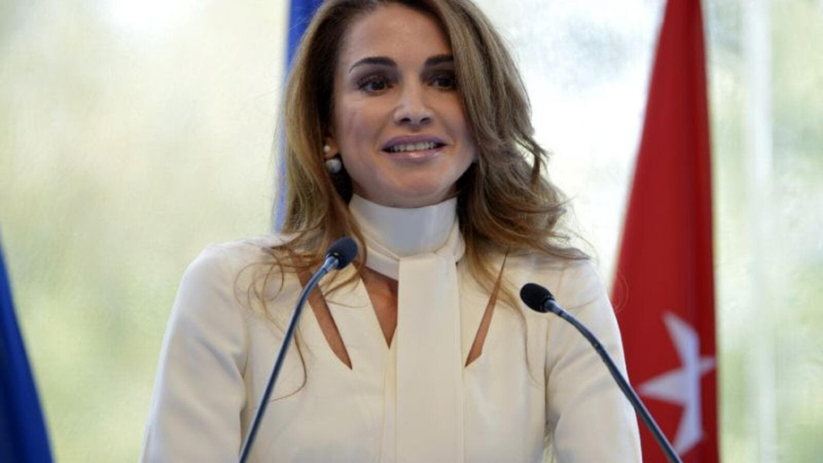 Queen Rania of Jordan delivers her speech at the Medef Summer Conference. (AFP Photo/Eric Piermont)