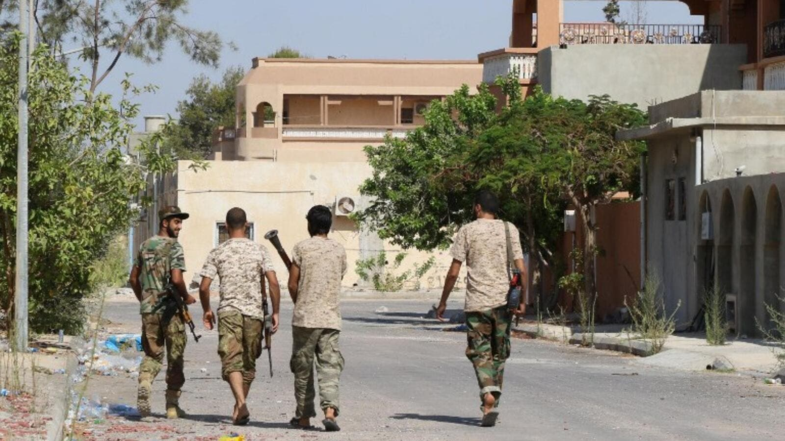 Fighters from the pro-government forces loyal to Libya's Government of National Unity (GNA) walk on August 3, 2016 in Sirte during an operation against Daesh. (AFP/Mahmud Turkia)