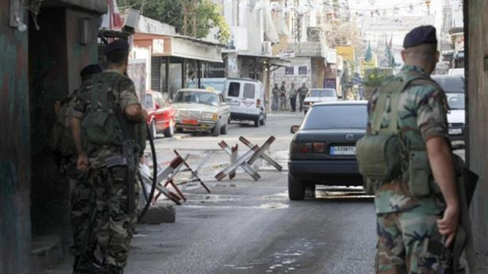 Members of Lebanese General Security observe passing cars at a checkpoint. (AFP/File)