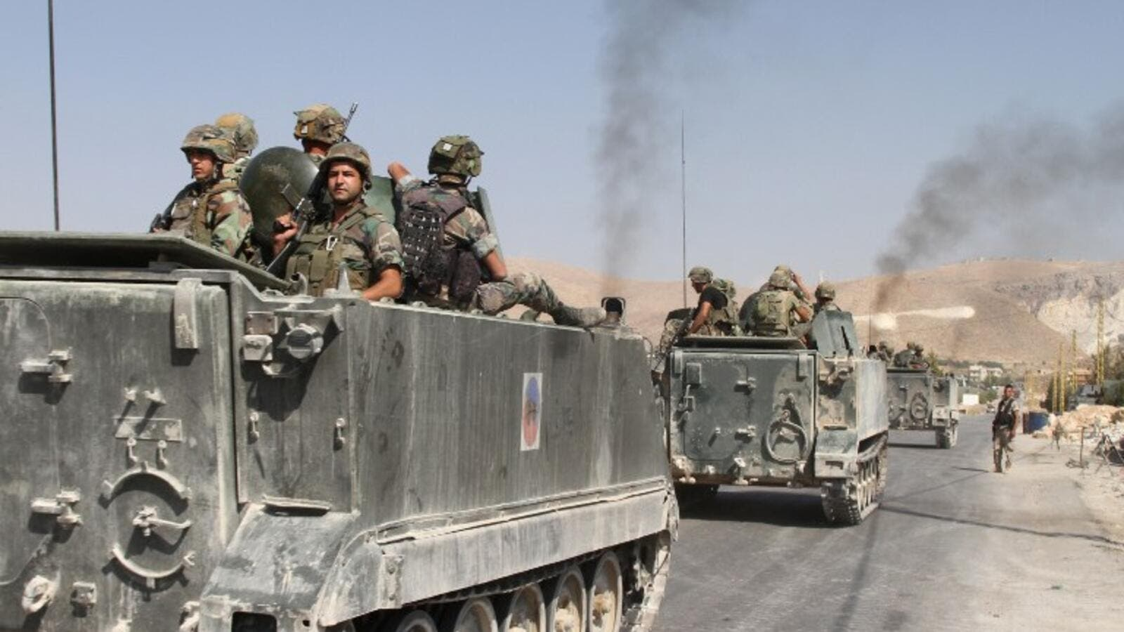 A file photo of Lebanese military vehicles driving through the border town of Arsal. (AFP/File)