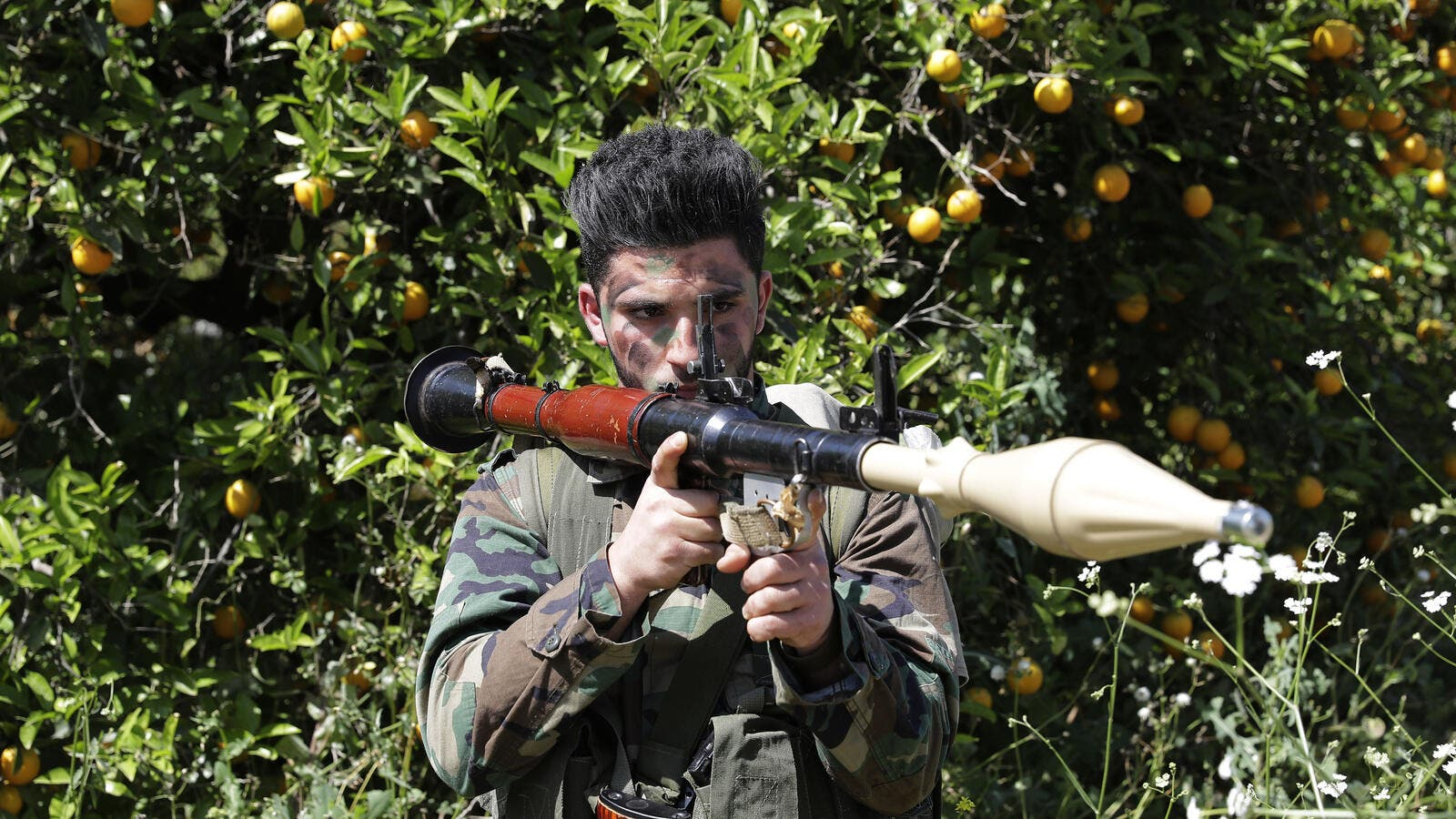 A Hezboallah fighter armed with an RPG stands near Lebanon's border with Israel, April 20 2017. (AFP/Joseph Eid)