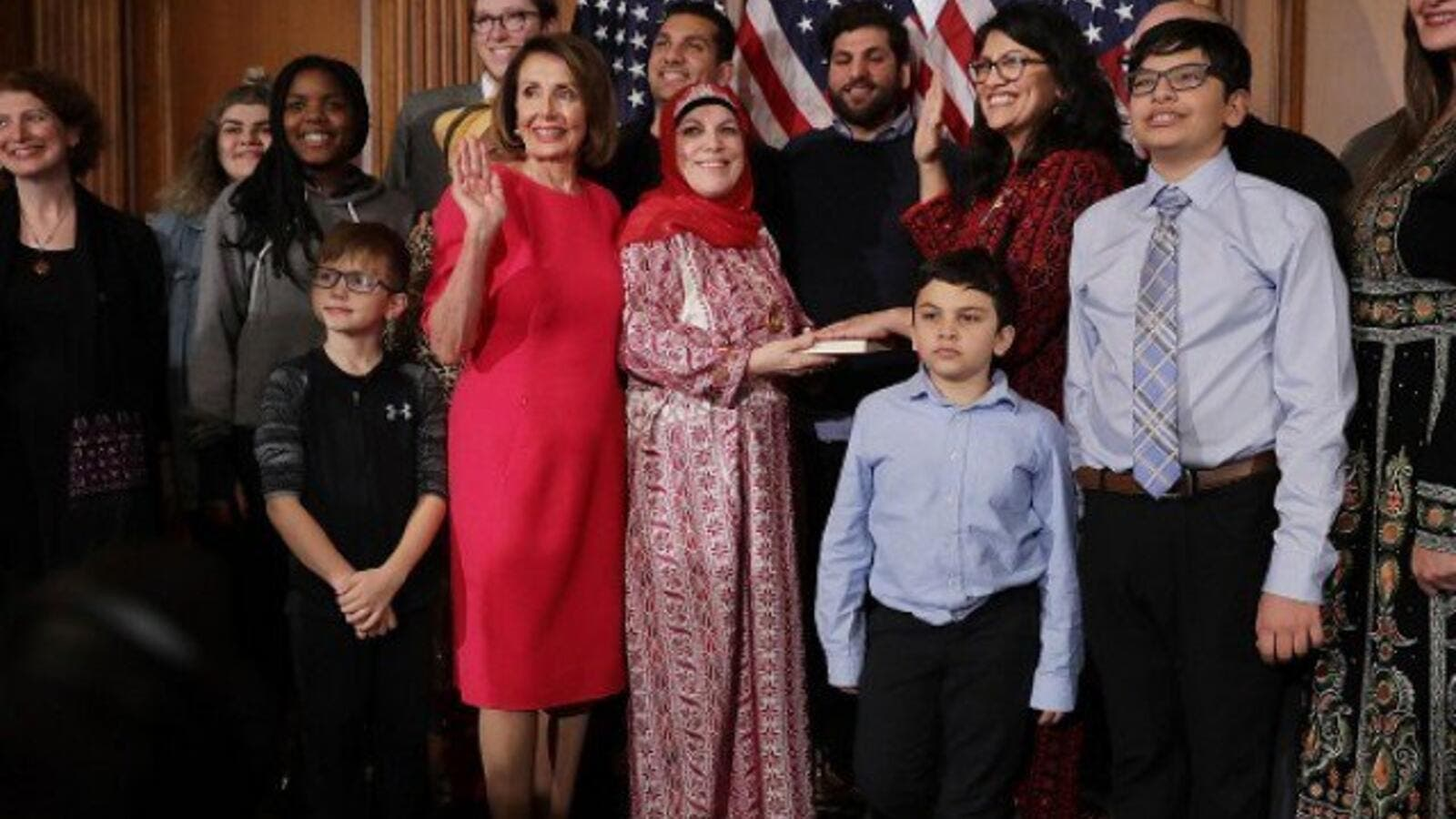 Speaker of the House Nancy Pelosi with Rep. Rashida Tlaib and her family in the Rayburn Room at the U.S. Capitol January 03, 2019 in Washington, DC. (AFP)