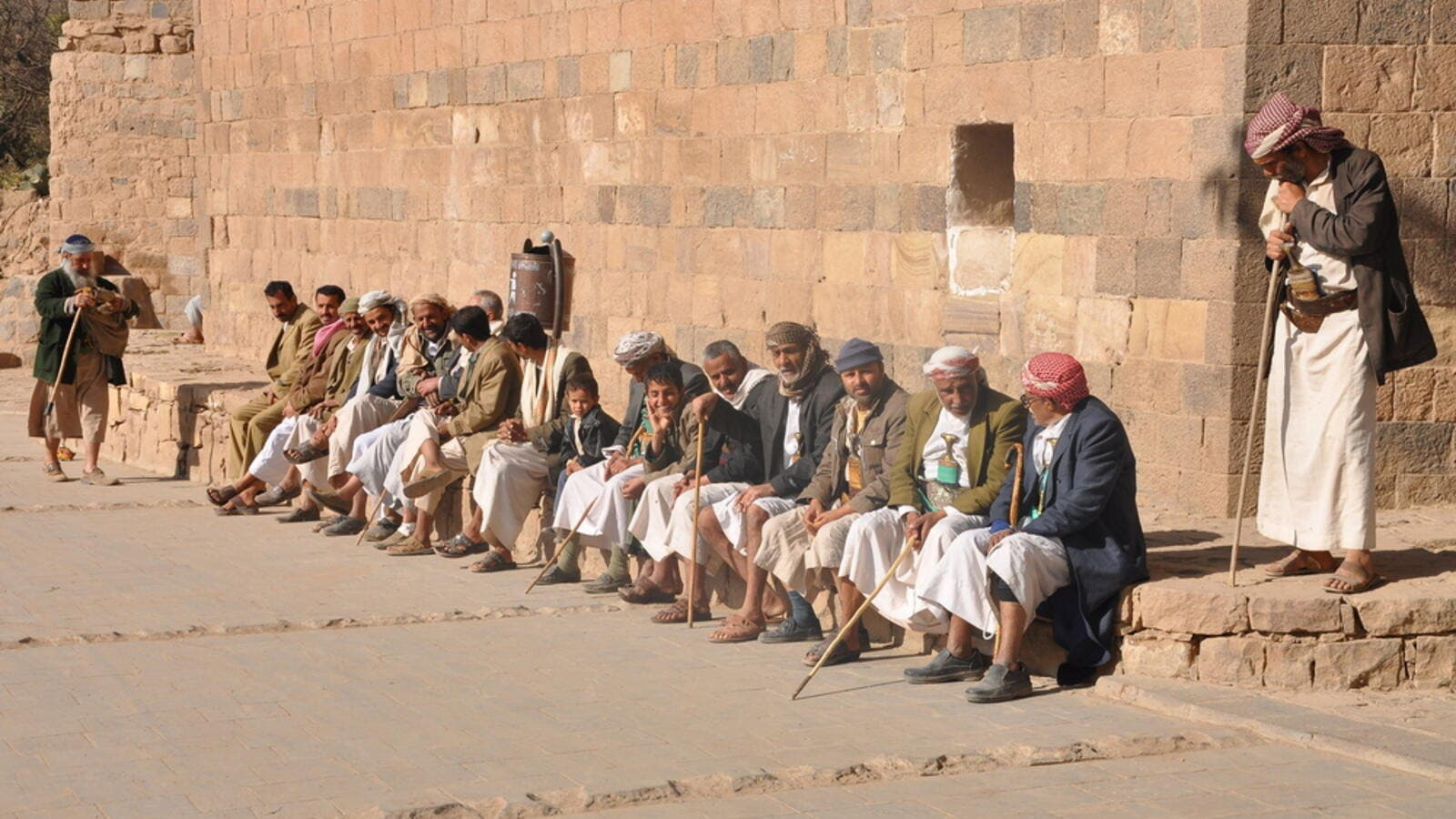 Men sit on the main square of Thula, Yemen (Shutterstock/File Photo)