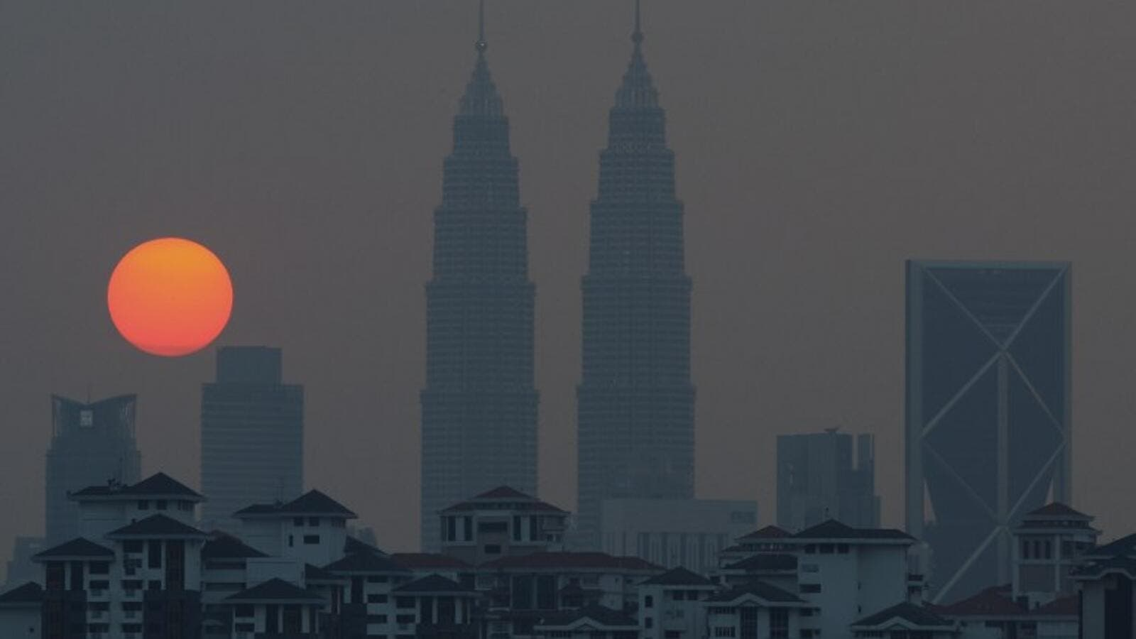 Malaysia's capital, Kuala Lumpur, is growing increasingly unwelcoming to Syrian refugees. (AFP/Mohd Rasfan)