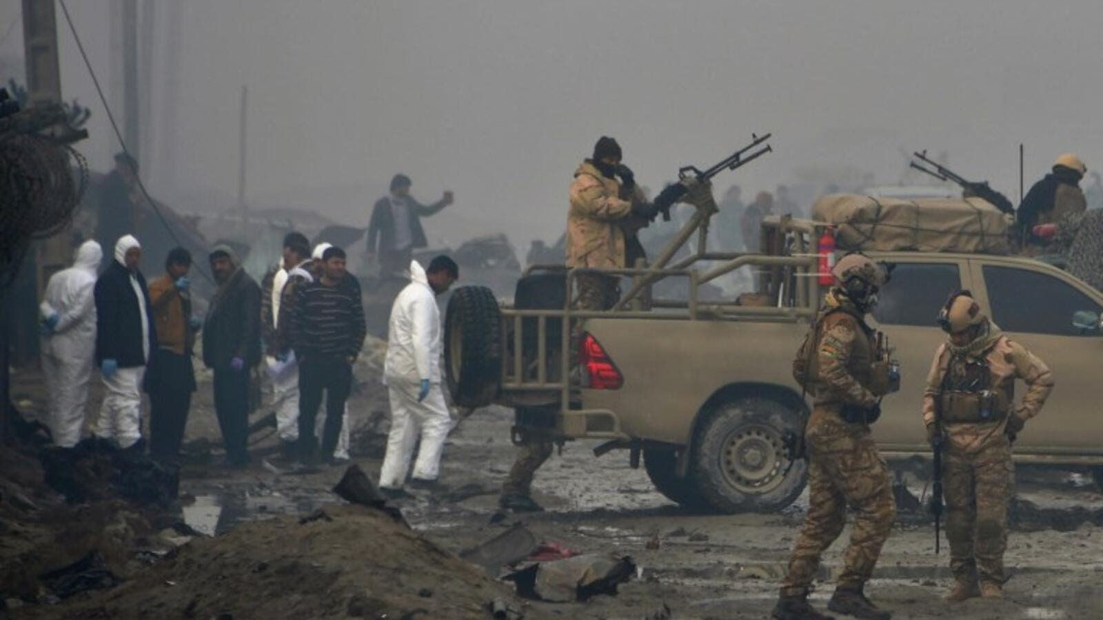 Afghan security forces and investigators gather at the site of a suicide bomb attack outside a British security firm's compound in Kabul, a day after the blast on November 29, 2018. (NOORULLAH SHIRZADA / AFP)