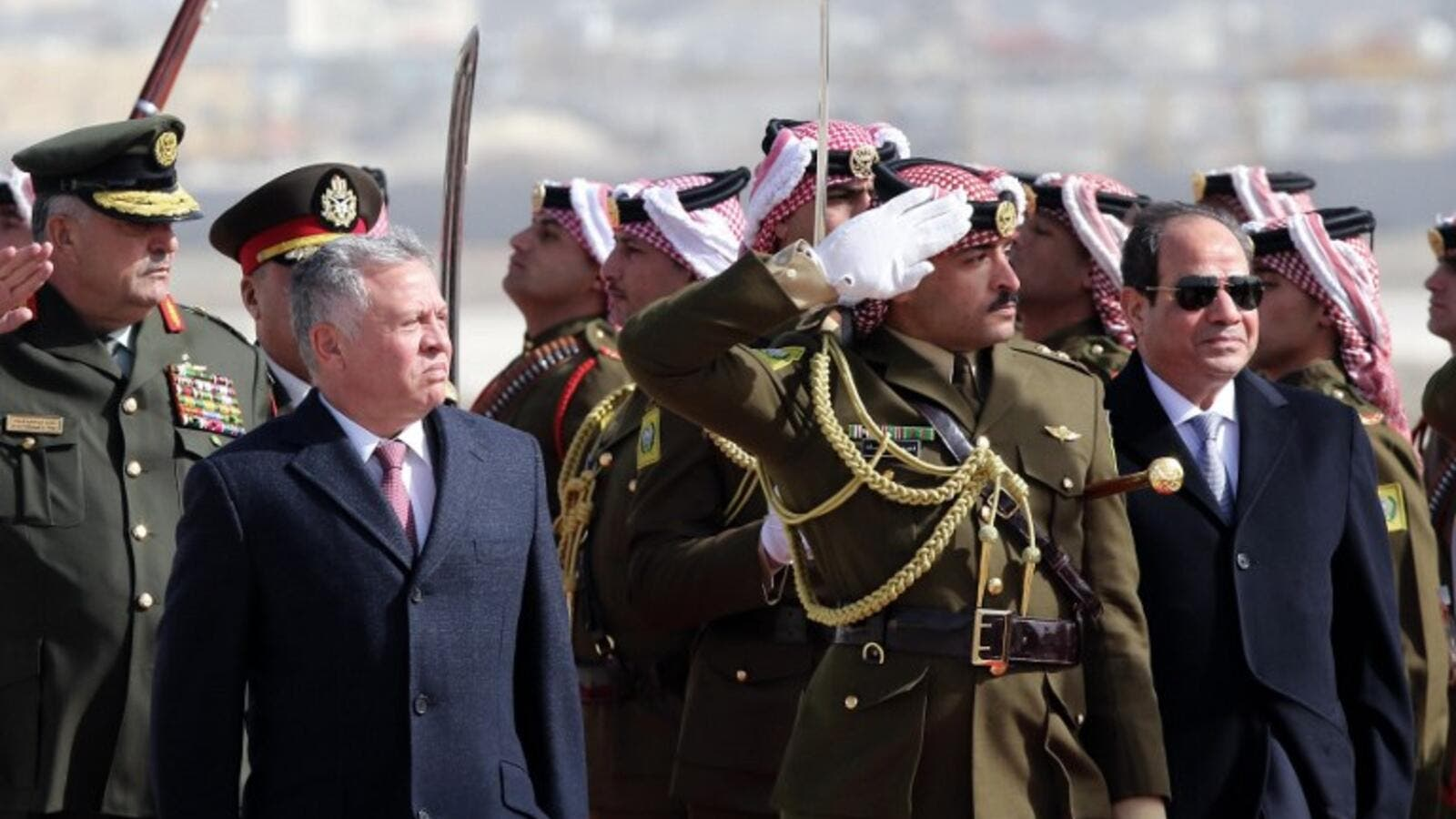 King Abdullah II of Jordan (L) and Egyptian President Abdel Fattah al-Sisi review an honour guard upon Sisi's arrival at Marka International Aiport, in the Jordanian capital Amman on January 13, 2018.(AFP)