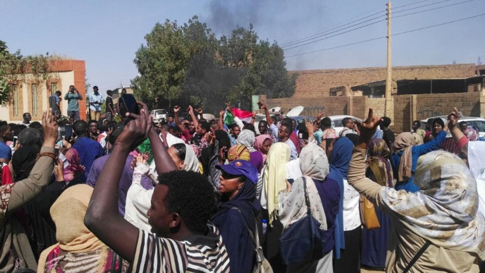 Sudanese protesters chant slogans during an anti-government demonstration in Khartoum's twin city of Omdurman on March 10, 2019. (AFP/File)