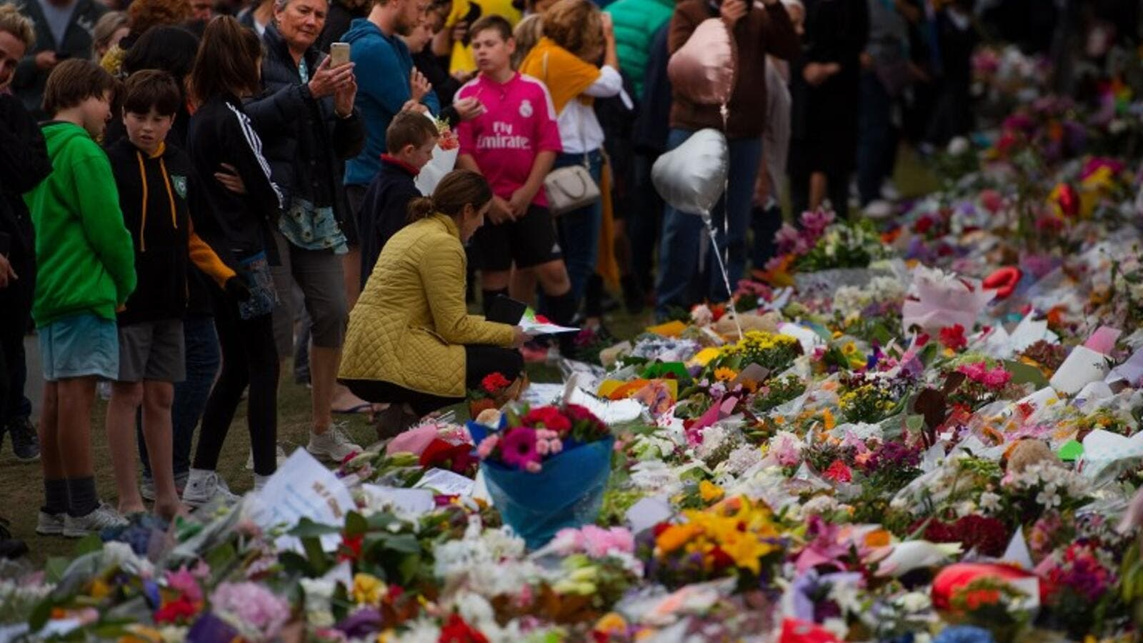 People pay their respects at a memorial site at the Botanical garden in Christchurch on March 18, 2019, three days after a shooting incident at two mosques. (AFP/ File)