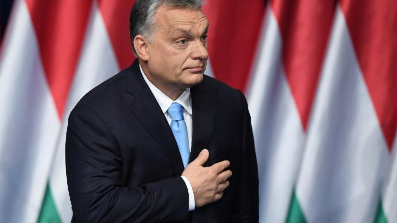 Hungarian Prime Minister and Chairman of FIDESZ party Viktor Orban reacts after delivering his state of the nation speech in front of his party members and sympathizers at Varkert Bazar cultural center in Budapest. (AFP)