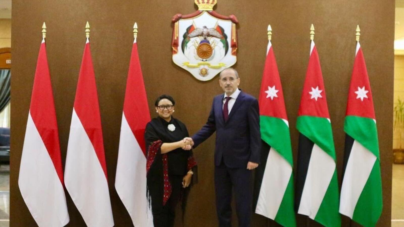 Foreign Minister Ayman Safadi (left) with the Indonesian counterpart Retno Marsudi on Tuesday in Amman (Twitter/ @AymanHsafadi)