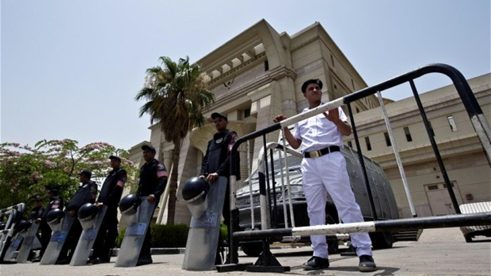Egyptian riot policemen stand guard outside the constitutional court in Cairo. (AFP/File)
