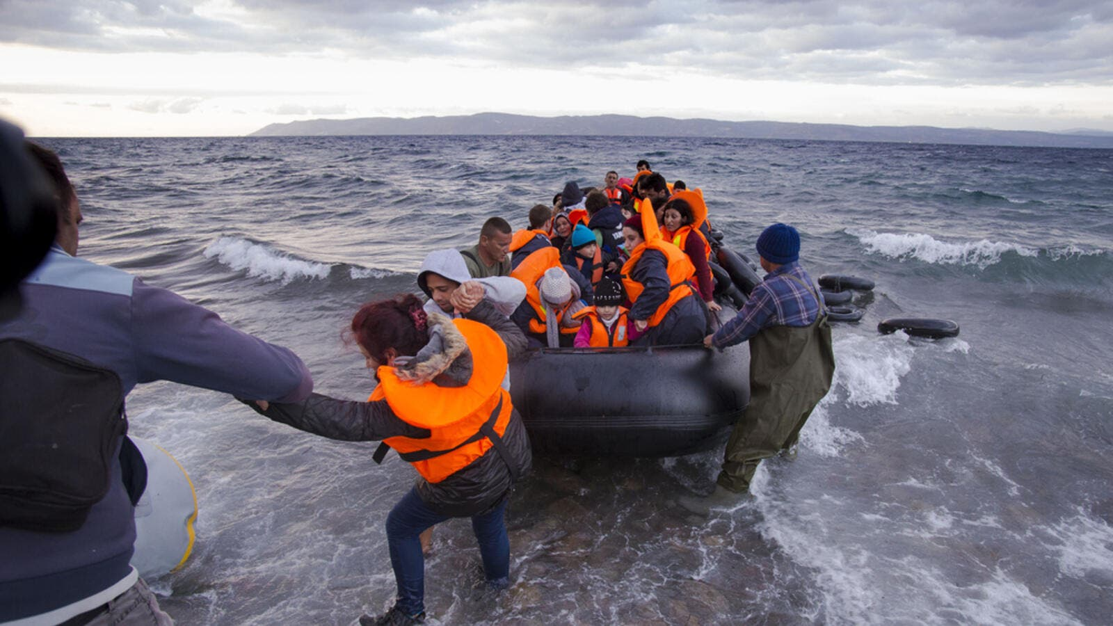 Syrian migrants arrive from Turkey on boat through sea with cold water near Molyvos, Lesbos on an overload dinghy. (Shutterstock/ File Photo)