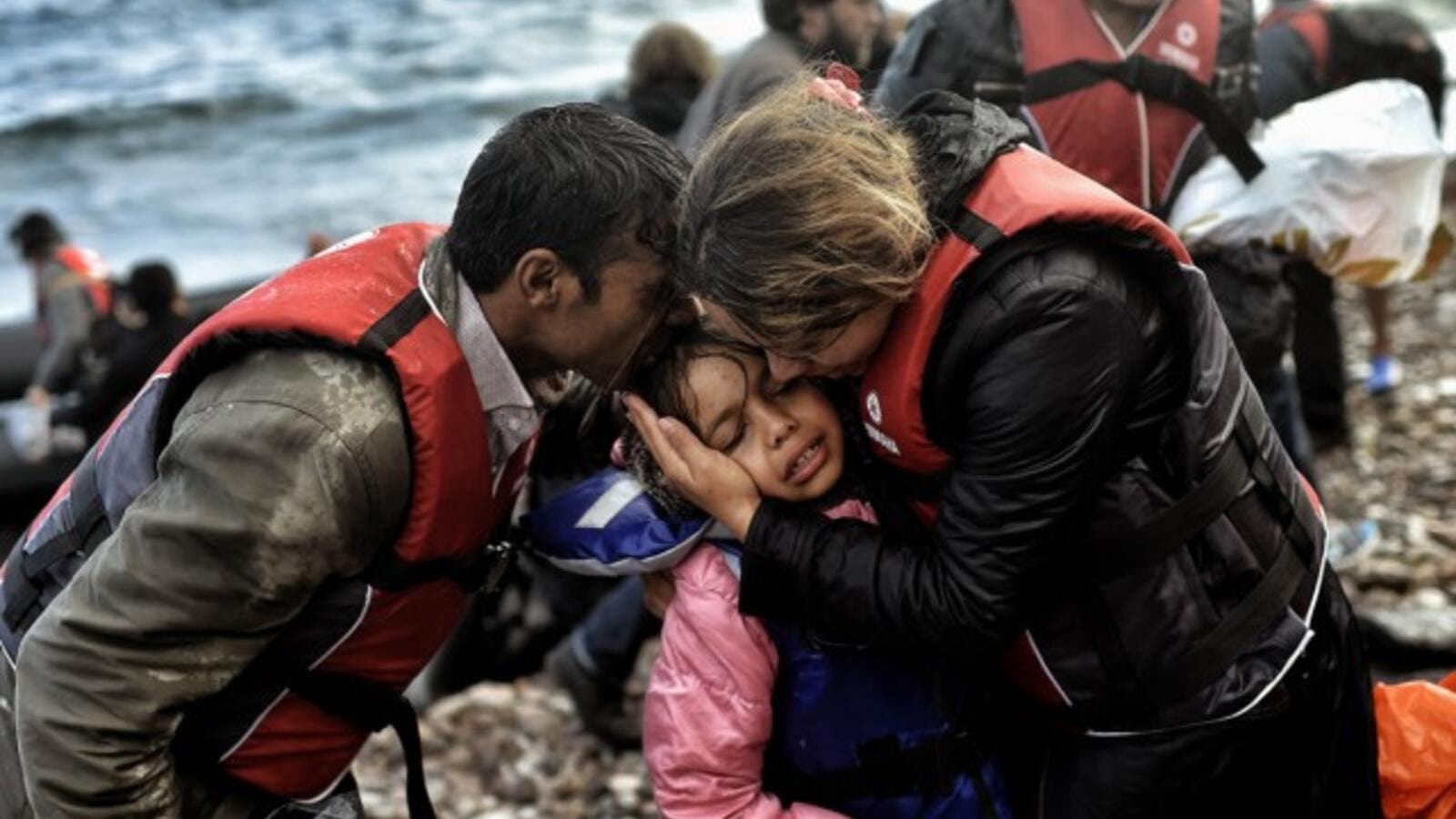 Syrian family becomes emotional after surviving the treacherous crossing between Turkey and Greece. (AFP/File)