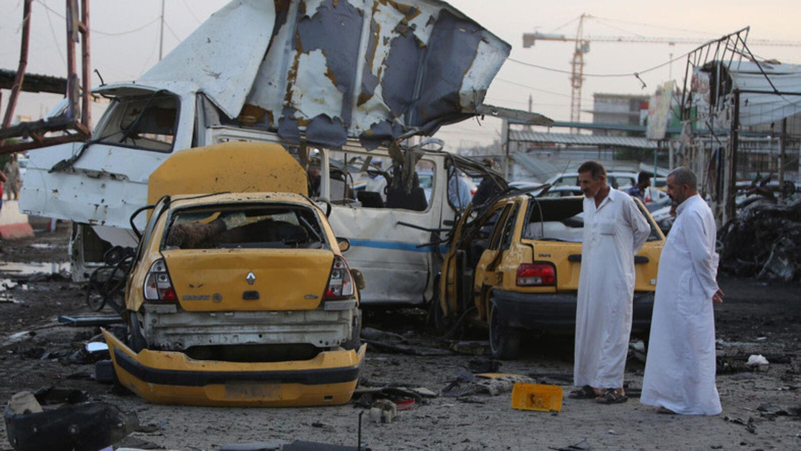 Two men inspect the aftermath of a Baghdad suicide bombing. (AFP/File)