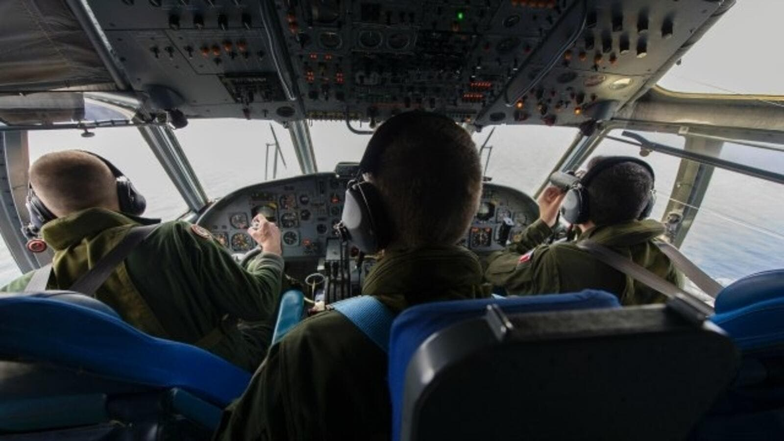 French soldiers aboard an aircraft search for debris from the crashed EgyptAir flight MS804 over the Mediterranean Sea. Egypt enlisted a submarine on May 22 to search the Mediterranean seabed for the black boxes of EgyptAir MS804. (AFP/File)