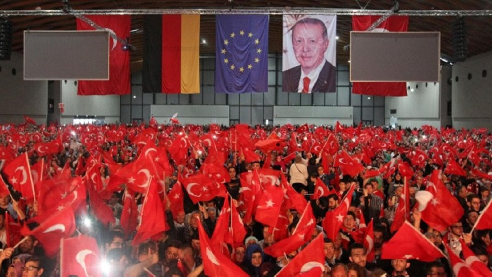 Supporters of Turkish President Recep Tayyip Erdogan wave Turkish flags. (AFP/File)