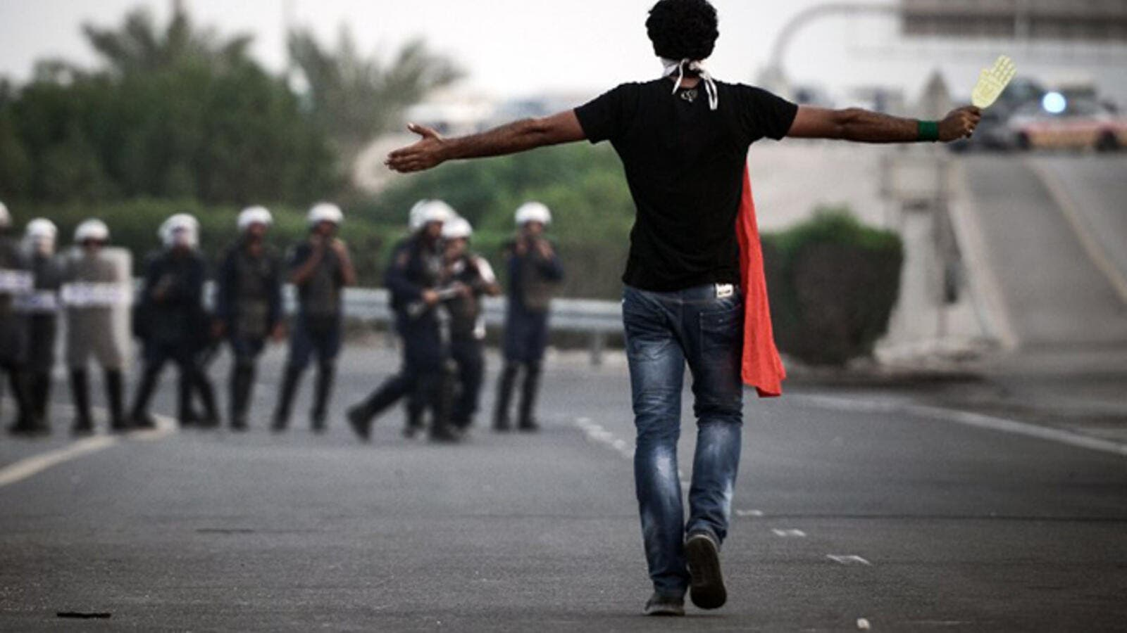 A Bahraini protester walks towards local riot police. (AFP/Mohammed Al Shaikh)