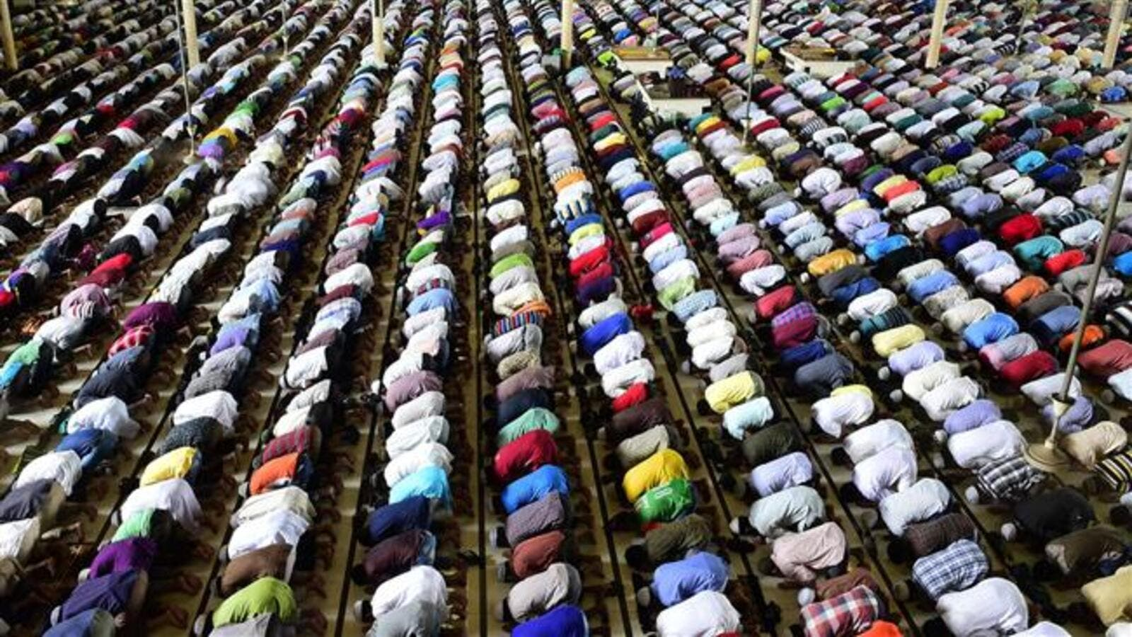 Bangladeshi Muslims offer Eid prayers at the start of the Eid al-Fitr holiday marking the end of Ramadan in Dhaka on July 18, 2015. (AFP/File)