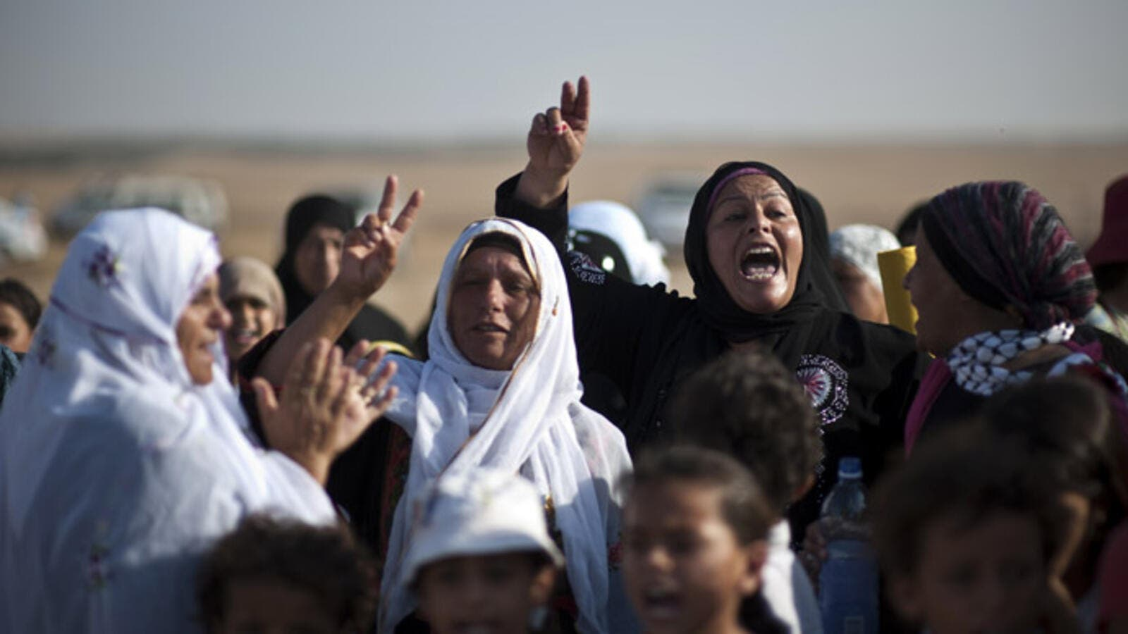 Bedouin women shout slogans during a protest in the Negev desert. (AFP/File)