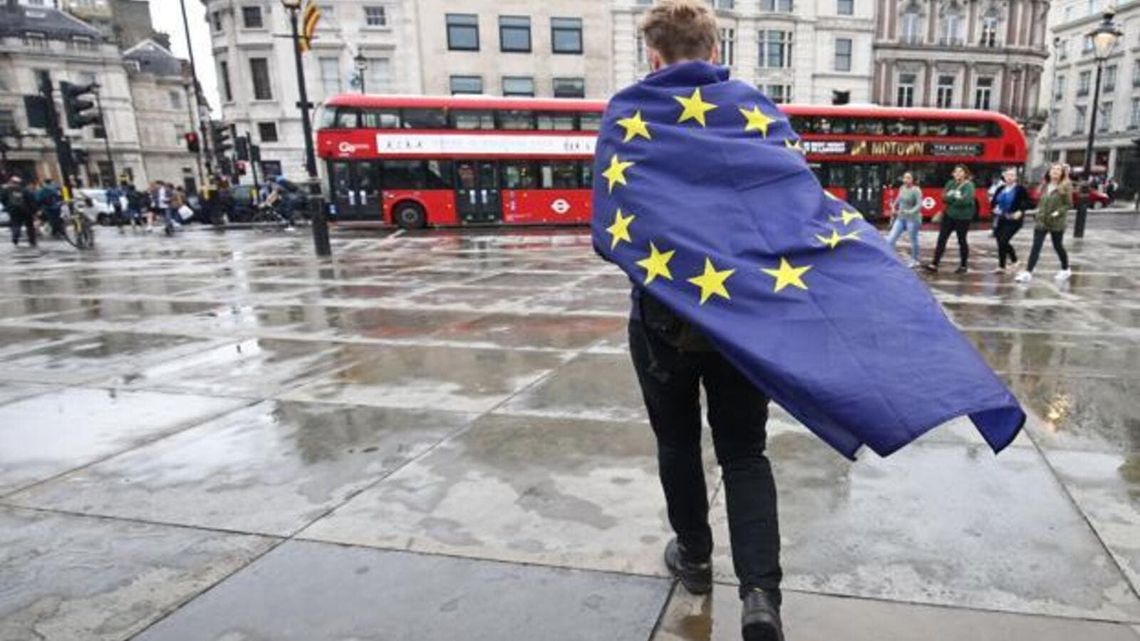 A demonstrator wrapped in a European flag leaves an anti-Brexit protest in Trafalgar Square, London. (AFP/File)