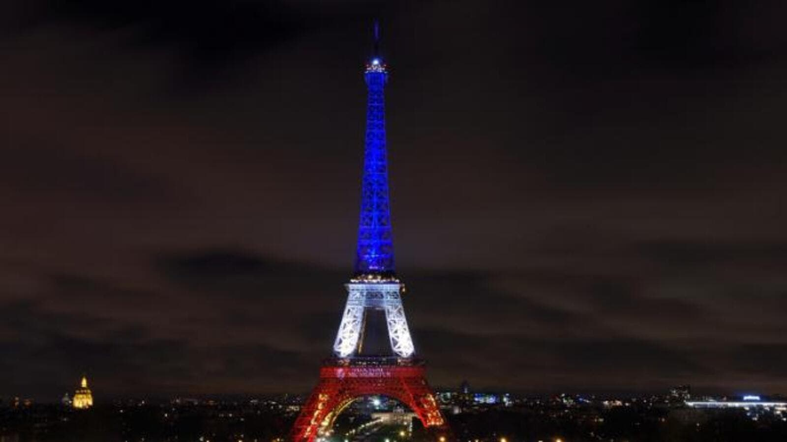 The Eiffel Tower is illuminated with the colours of the French national flag. (AFP/File)