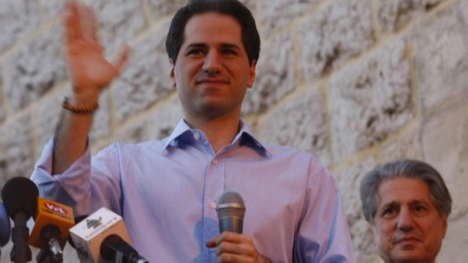 Lebanese Maronite Christian MP Sami Gemayel waves to the crowd. (AFP/File)