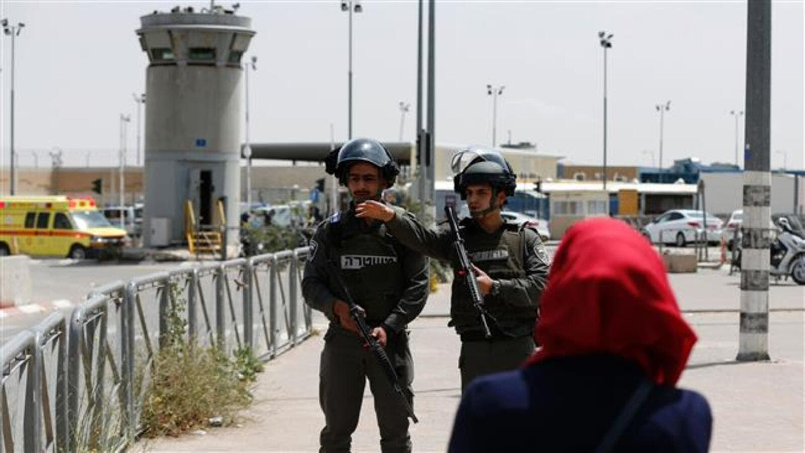 Israeli soldiers stand guard at the Qalandiya checkpoint. (AFP/File)