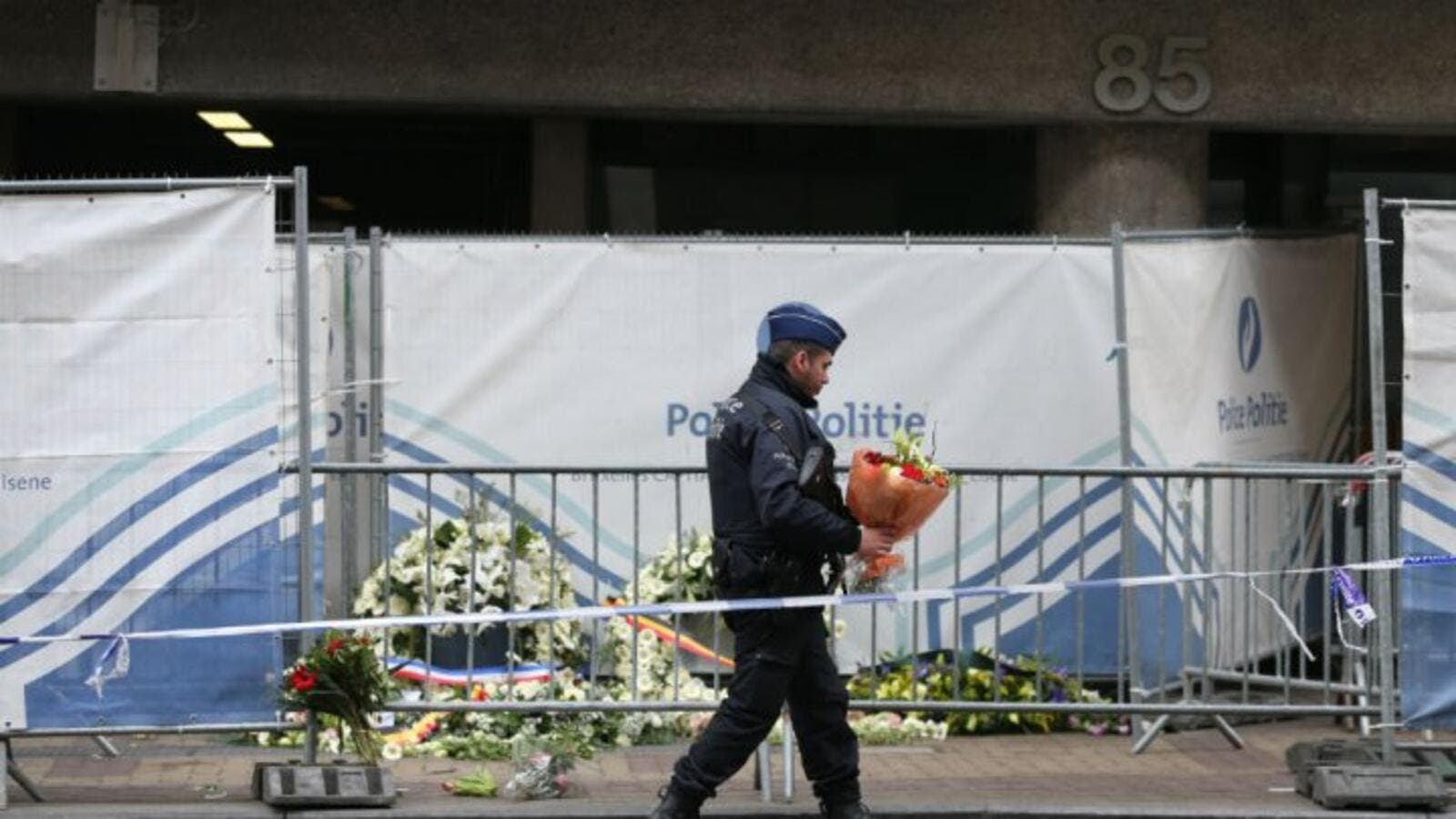 A security official lays flowers at the memorial site at Maalbek metro station. (AFP/File)