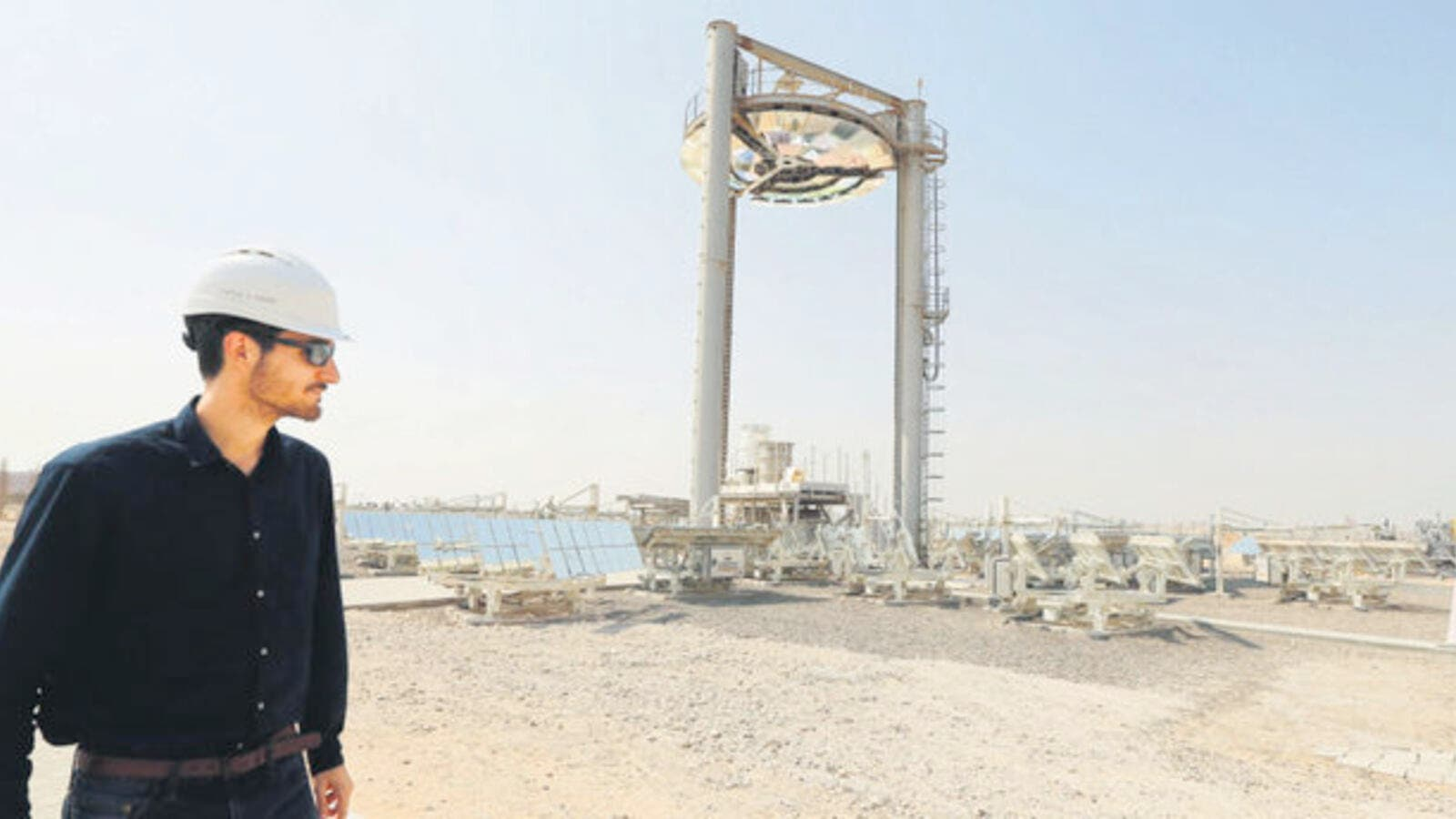 An employee walks at a solar plant in Masdar outside the Emirate of Abu Dhabi. (AFP/File)