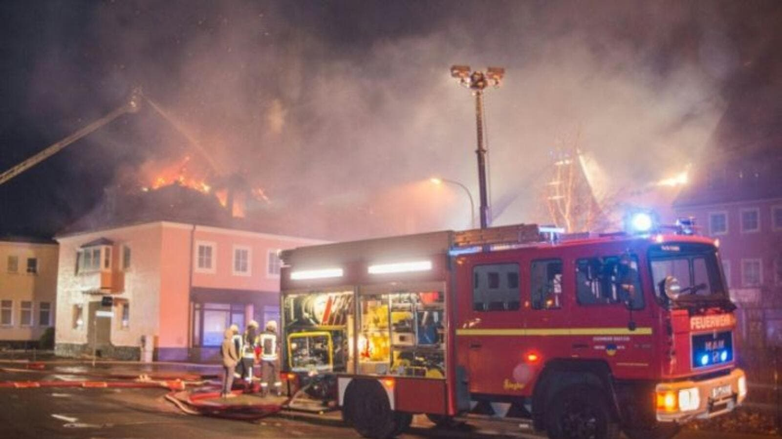 Fire fighters try to extinguish a fire at a former hotel that was under reconstruction to become a home for asylum seekers on February 21, 2016 in Bautzen east of Dresden, eastern Germany. (AFP/Rico Loeb)