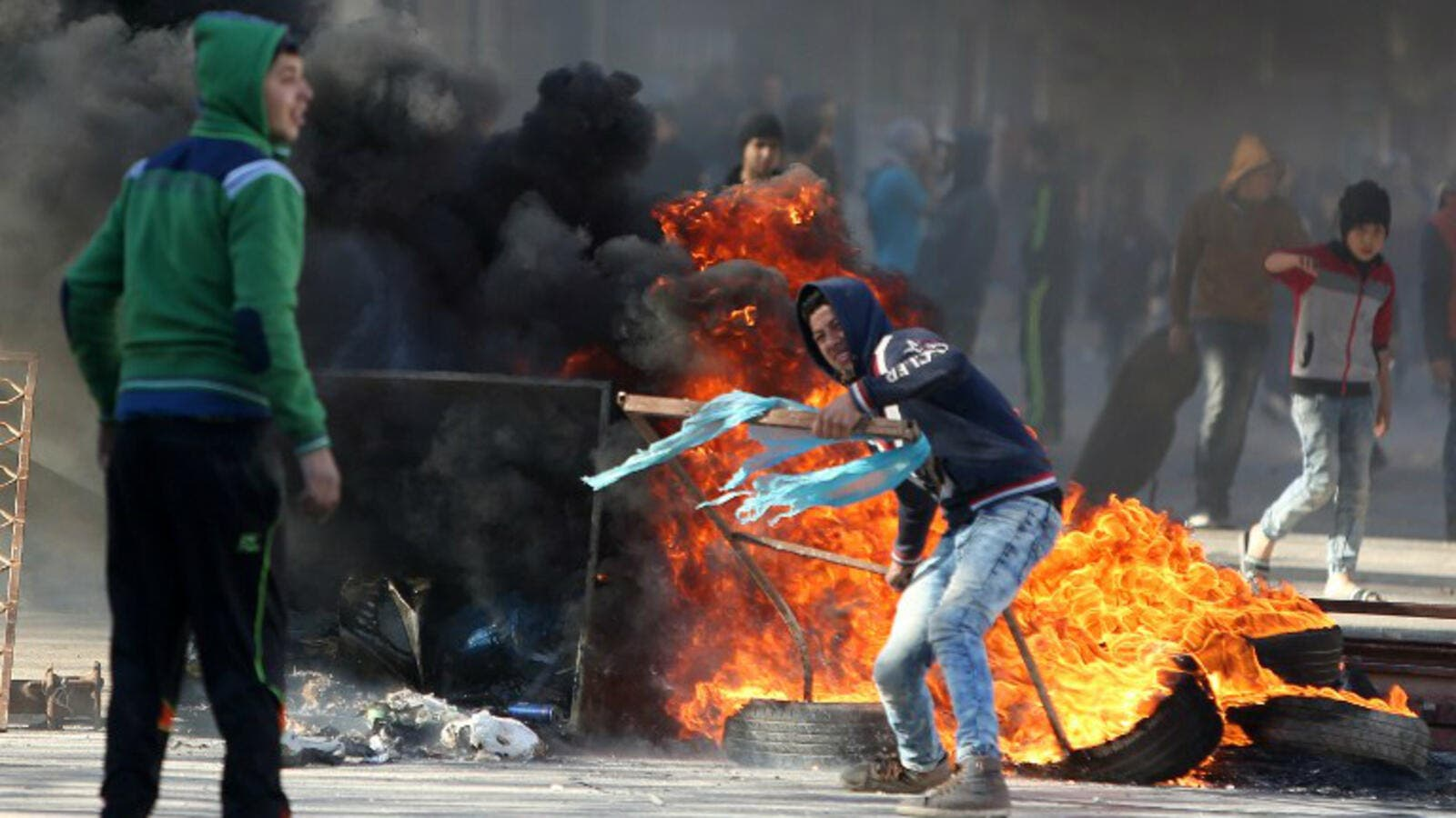 Palestinian youths clash with Israeli security forces in Qabatiya, a town near Jenin. (AFP/File)