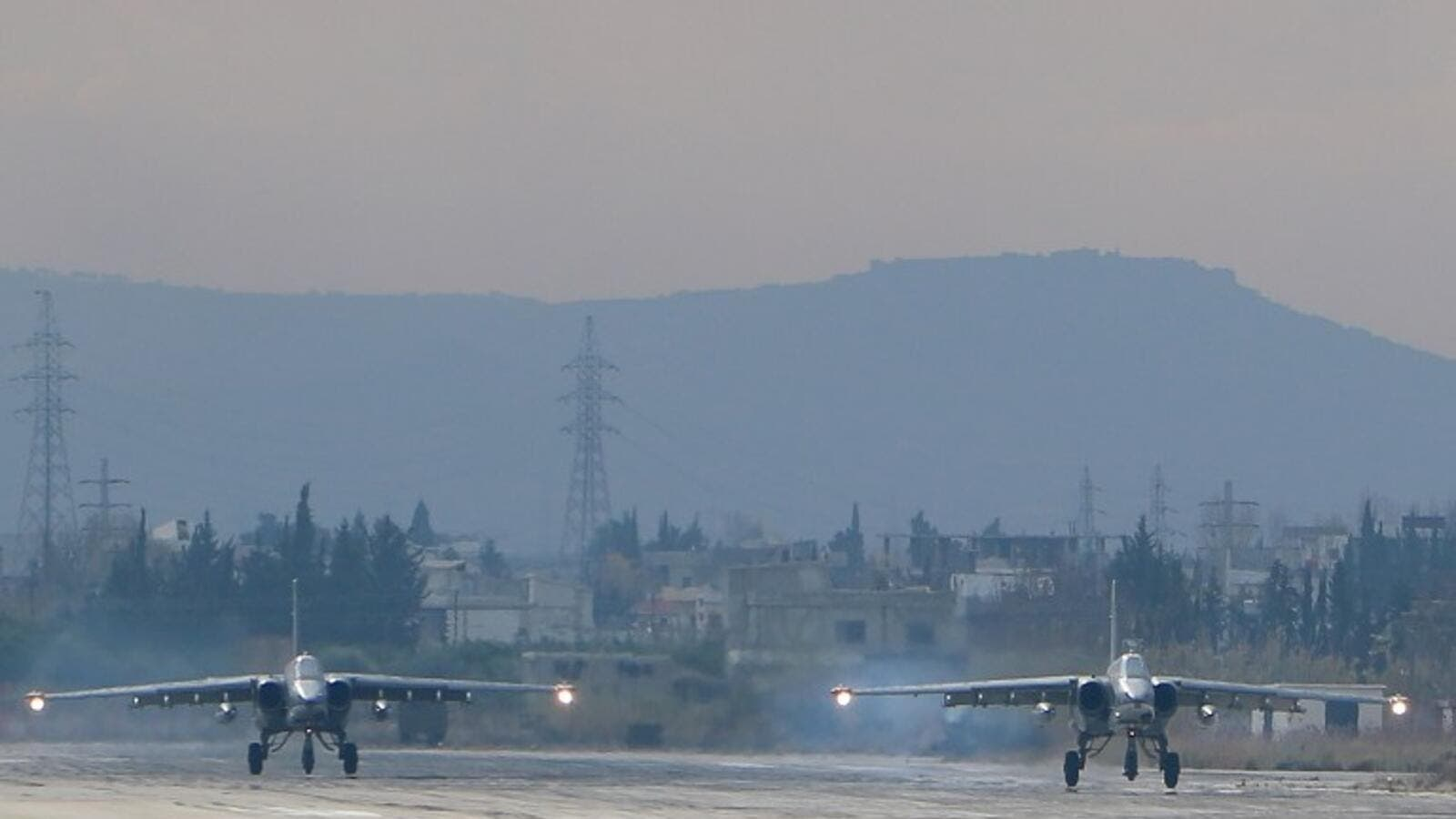 Two Russian Sukhoi Su-24 bombers at the Russian Hmeimim military base in Latakia province. (AFP/File)