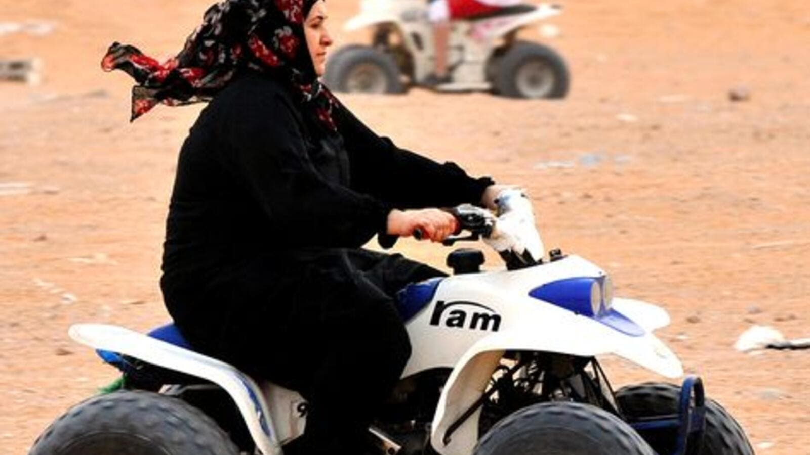 The picture of happiness: A Saudi woman drives an ATV (all-terrain vehicle). (AFP/File)