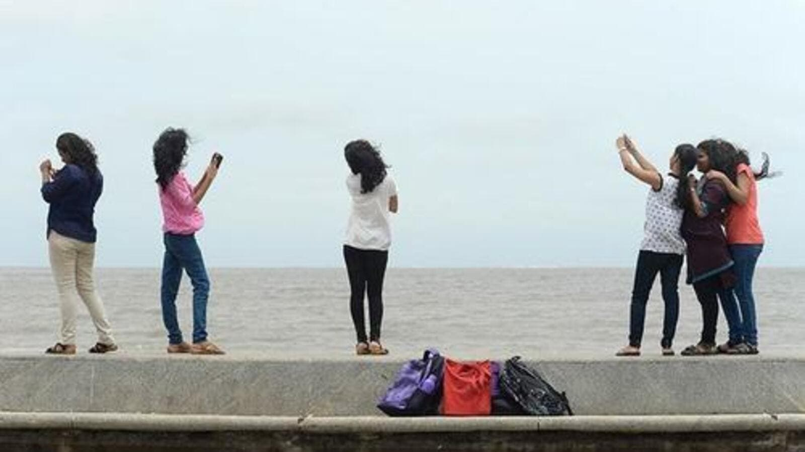 Tourists pose for a selfie. (File photo)