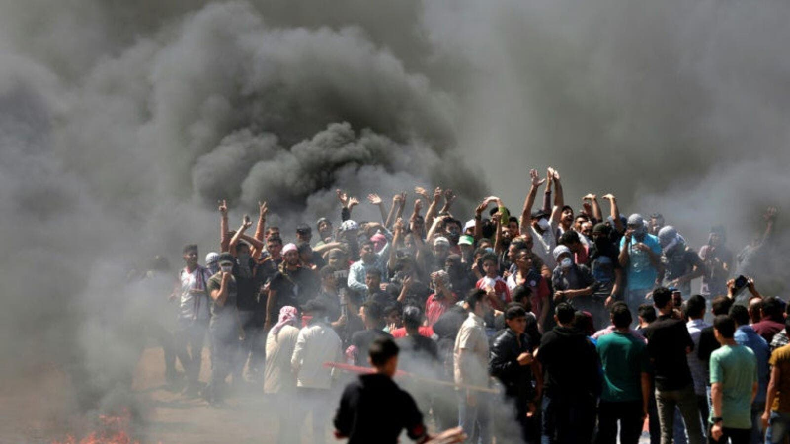 Palestinians burn tyres near the Strip border on May 14, 2018. (AFP/File Photo)