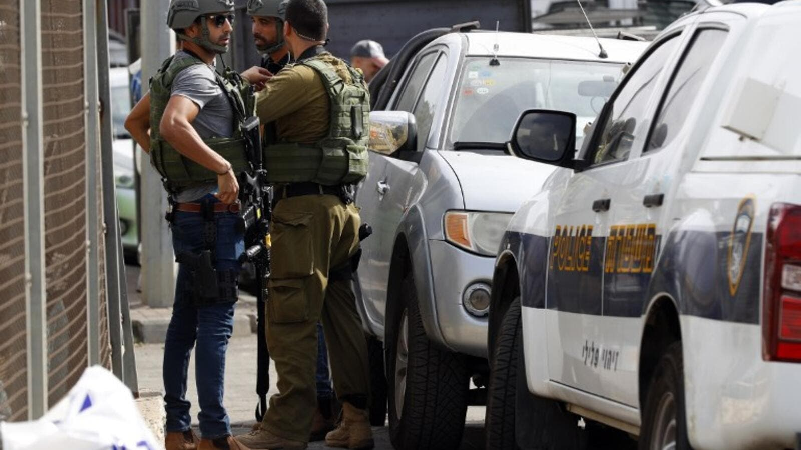 Israeli security forces gather at the site of a reported attack. (Jack GUEZ / AFP)