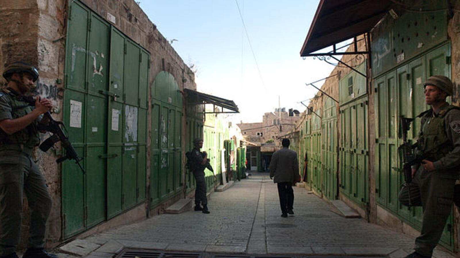 Closed shops on Shuhada street in Hebron, where the activists had been headed (Wikimedia Commons)