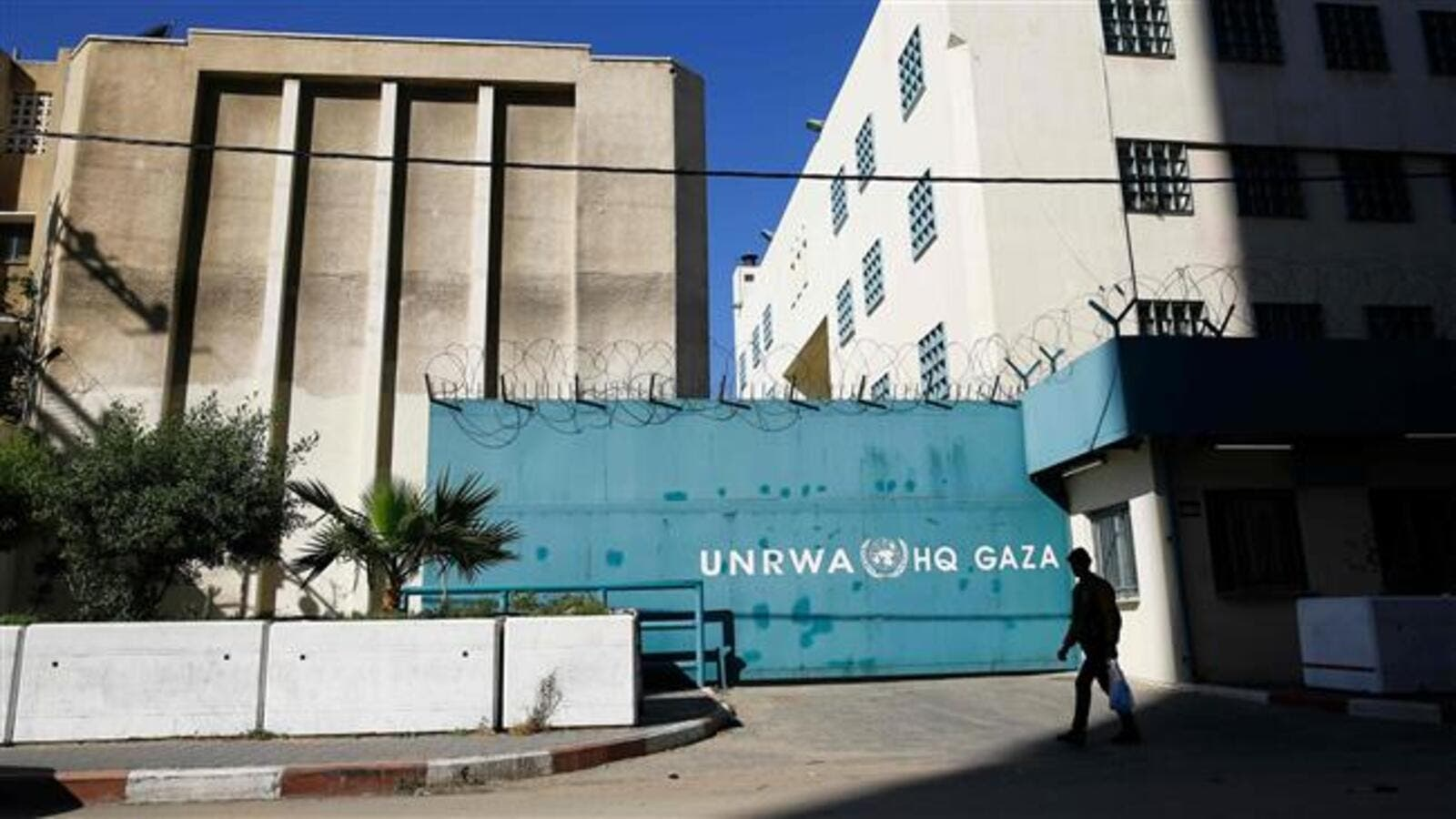 A Palestinian man walks past the building of the UNRWA headquarters in Gaza City on January 8, 2018. (AFP/ File Photo)