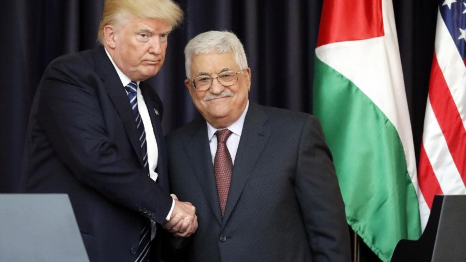 US President Donald Trump (L) and Palestinian leader Mahmud Abbas shake hands during a joint press conference at the presidential palace in the West Bank city of Bethlehem on May 23, 2017. (AFP/Thomas Coex)