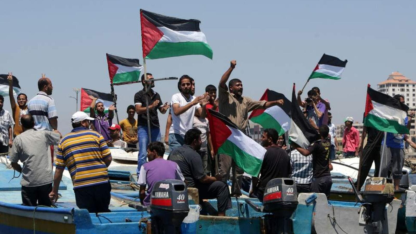 Palestinians rally, Tuesday, in the port of Gaza in support of a flotilla that aimed to break the blockade ( AFP/ File photo)