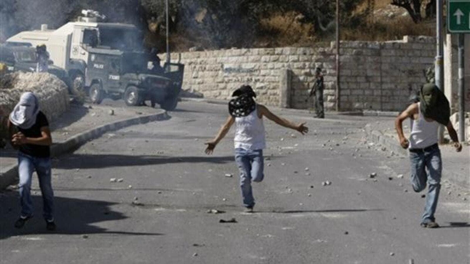 alestinian stone throwers and Israeli forces clash in the mostly Arab east Jerusalem neighbourhood of Silwan on October 15, 2010. Police in Jerusalem are systematically breaking the law by arresting stone-throwing children at night and interrogating them without their parents, an Israeli rights group said on December 15, 2010