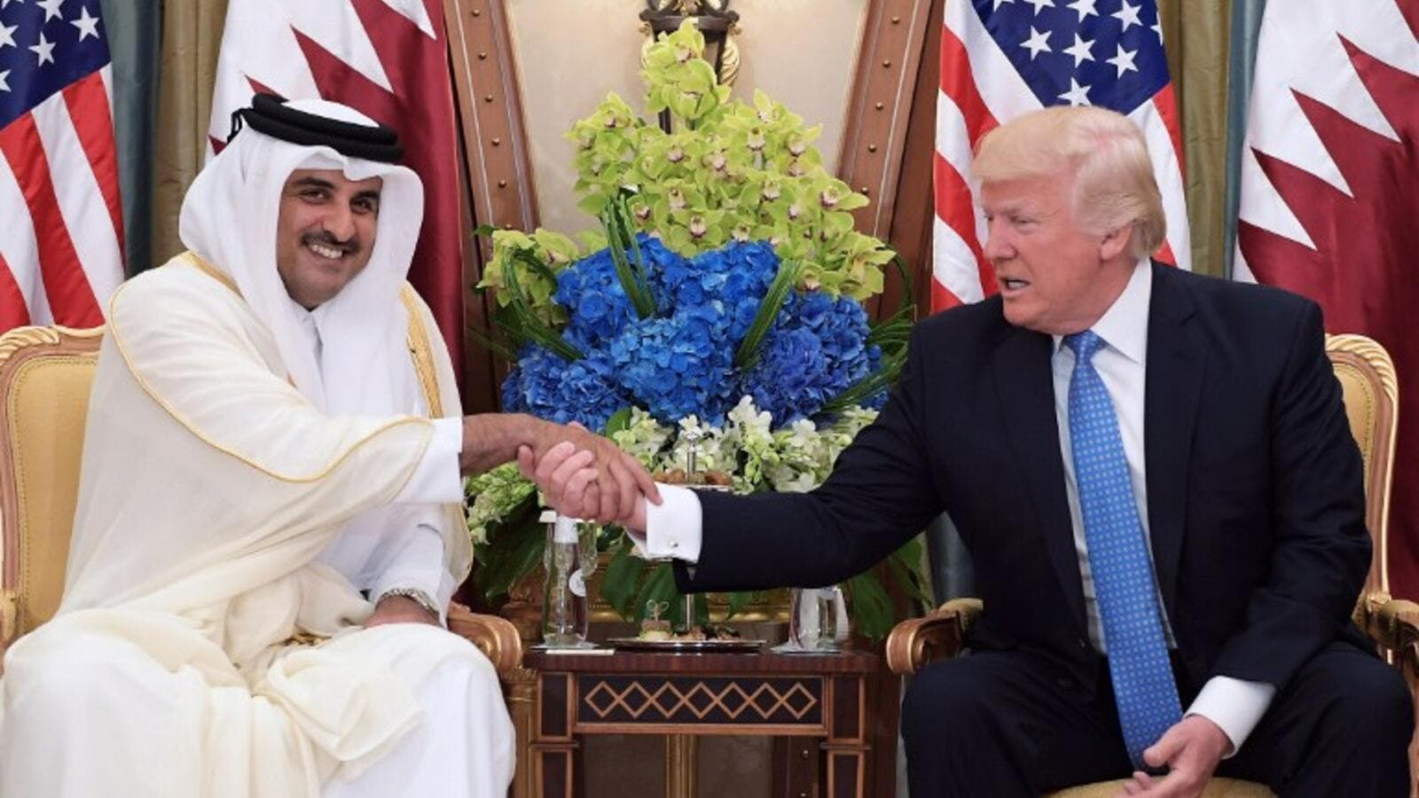 This file photo taken on May 21, 2017 shows US President Donald Trump (R) shaking hands with Qatar's Emir Sheikh Tamim Bin Hamad Al-Thani, during a bilateral meeting at a hotel in the Saudi capital Riyadh.(Mandel Ngan/AFP)