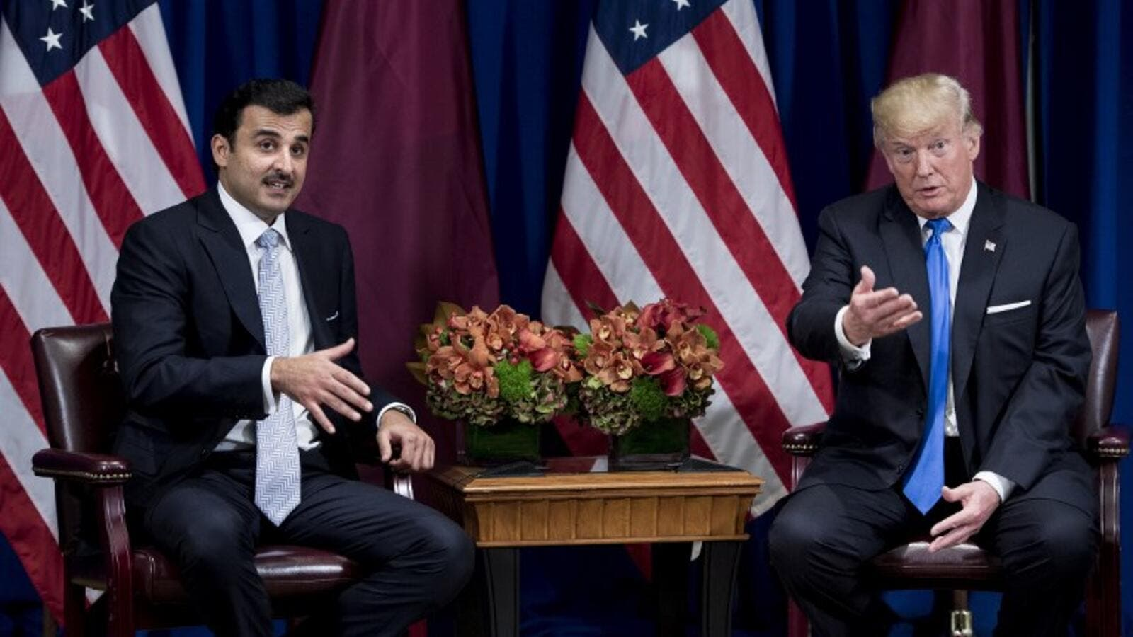 An awkward GIF has emerged from this excruciating meeting between US President Trump and Qatari Emir Sheikh Tamim bin Hamad Al Thani (AFP)
