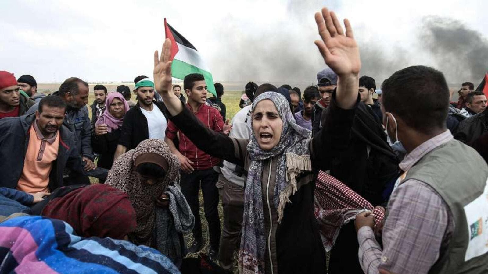 Palestinian demonstrators near the border with Israel (AFP)