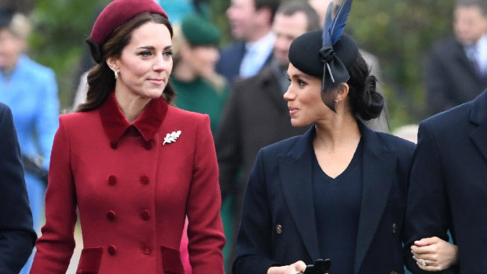 Britain's Catherine, Duchess of Cambridge (L) talks to Meghan, Duchess of Sussex as they arrive for the Royal Family's traditional Christmas Day service at St Mary Magdalene Church. (AFP/File)