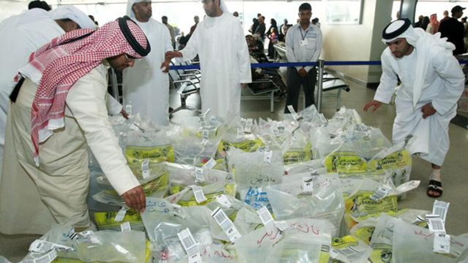 Saudis examine water samples from the Zamzam Well to check for contamination. (AFP/File)