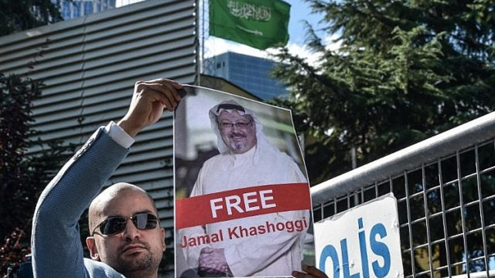 A protester holds a picture of missing journalist Jamal Khashoggi during a demonstration in front of the Saudi Arabian consulate. (AFP/File)