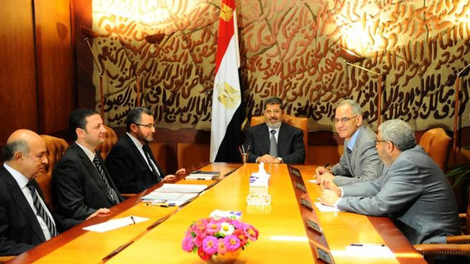 In this handout picture released by the Egyptian Presidency, Egyptian President Mohamed Morsi (C) meets with his prime minister Hisham Kandil (3rd L) and other ministers in Cairo on July 1, 2013.