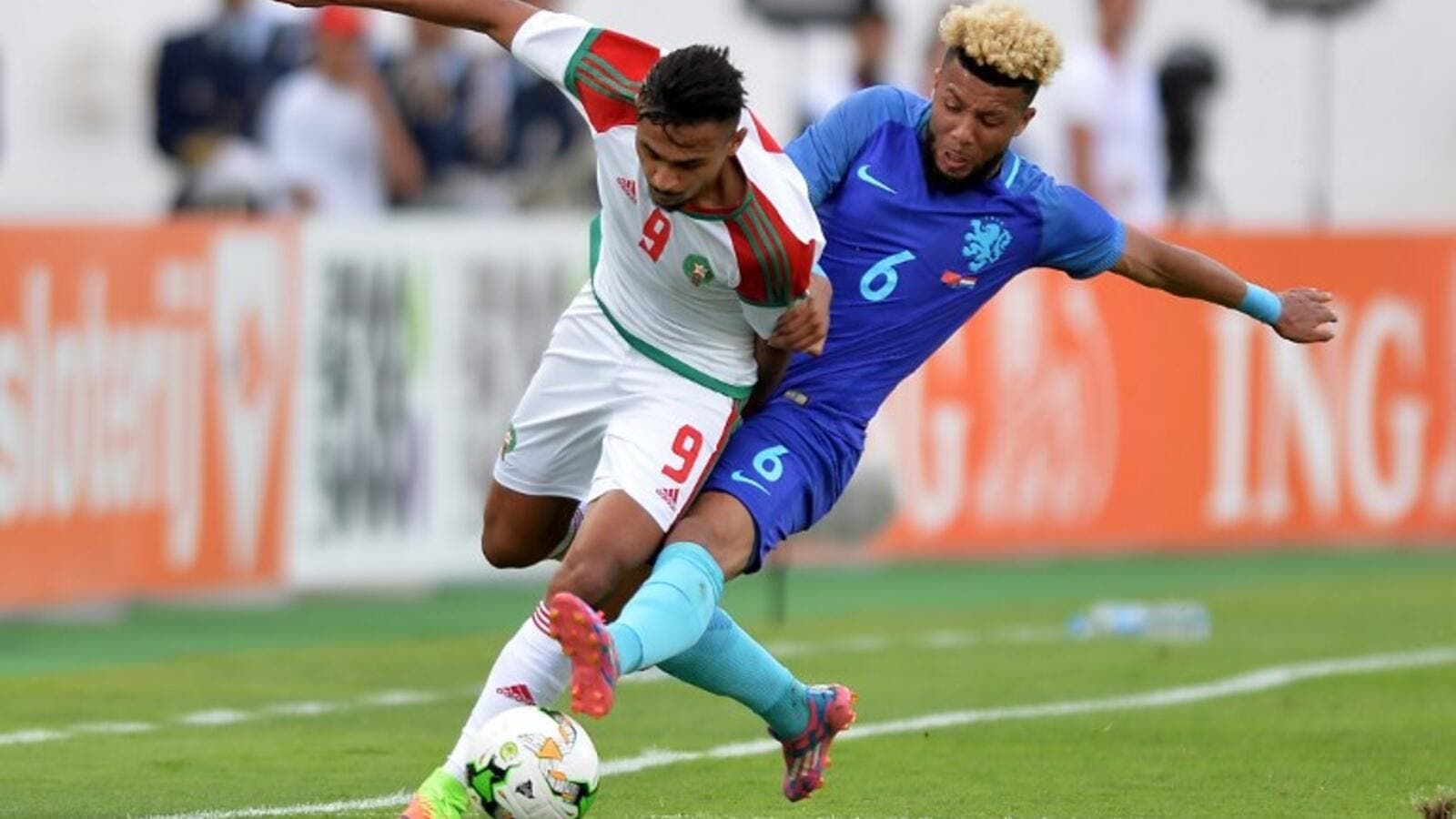 Morocco's Soufian Boufal (L) vies with Netherland's Tonny Vilhena during the international friendly football match between Morocco and Netherlands at in Agadir on May 31, 2017.