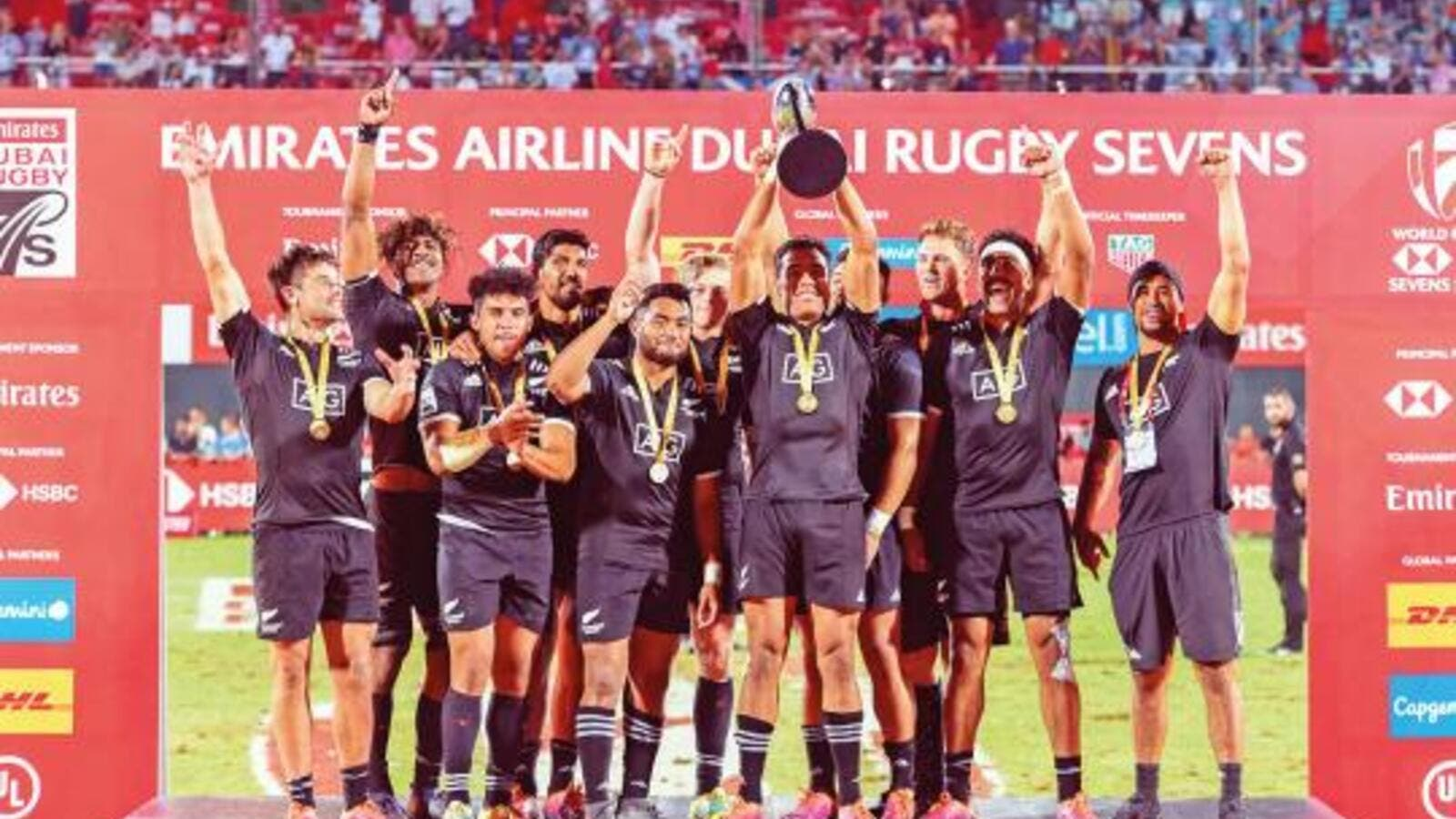 New Zealand team celebrate after clinching the Dubai Rugby Sevens title at The Sevens Stadium in Dubai. (Photo: Antonin Kélian Kallouche/Gulf News)